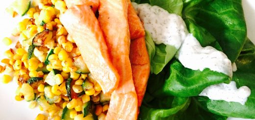 Tender slices of baked trout with corn & zucchini hash and boston lettuce salad