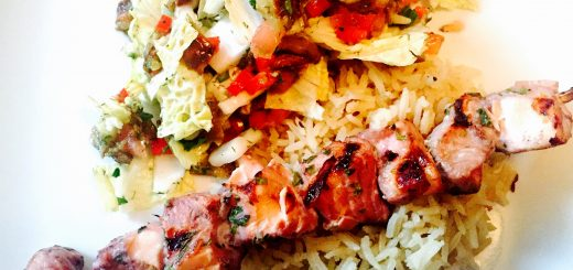 Turkmenistan salmon shashlik on rice with roasted eggplant salad