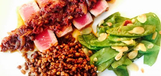 Seared tuna with a savoury sun-dried tomato reduction, some sliced almond snow peas and lovely roasted lentils