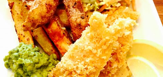 Crispy & delicious gluten free fish and chips with mushy peas, home cut fries and creamy dairy free coleslaw