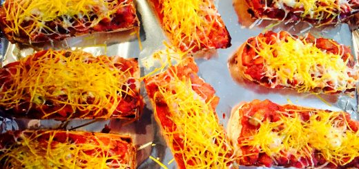 Ultimate comfort food ... Spaghetti sauce on gluten free baguettes with dairy free grated cheese broiled to perfection