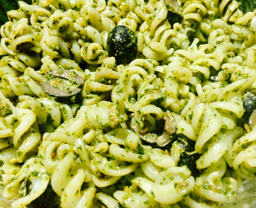 My dairy free, gluten free pesto pasta salad recipe with black olives is a delicious addition to any summer feast