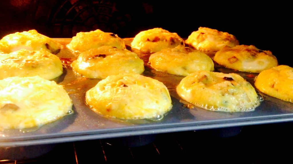 Lovely cheesy egg muffins puffing up nicely in a 350 oven