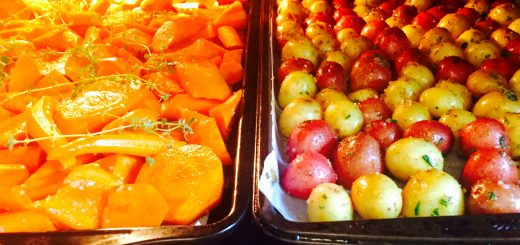 Herbed new potatoes & maple-glazed carrots roasting nicely in a 400° oven