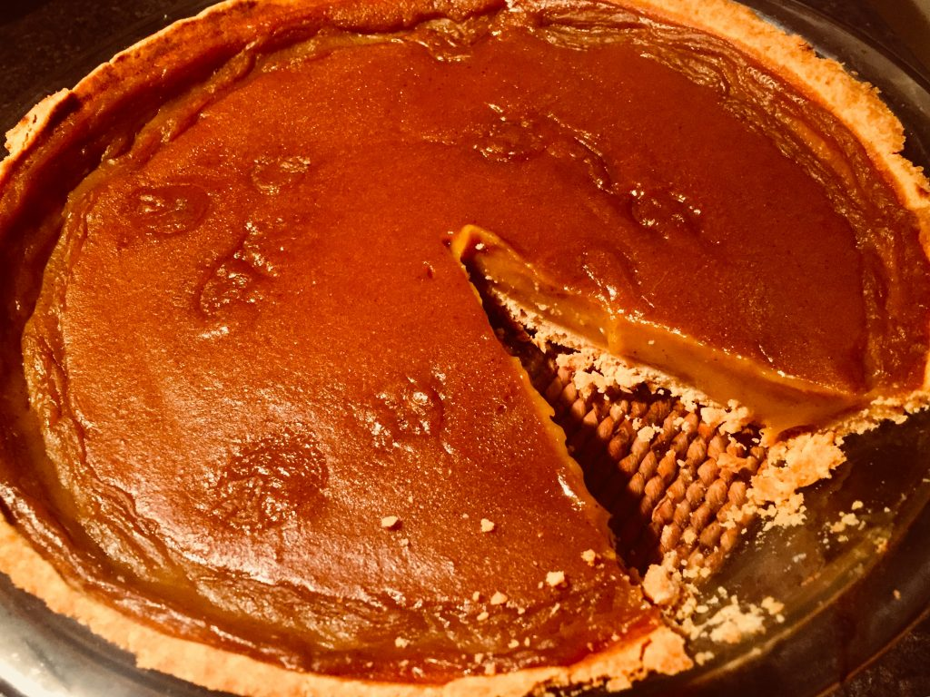 Delicious homemade pumpkin pie made from scratch with roasted pumpkin and a delicious gluten free pie shell