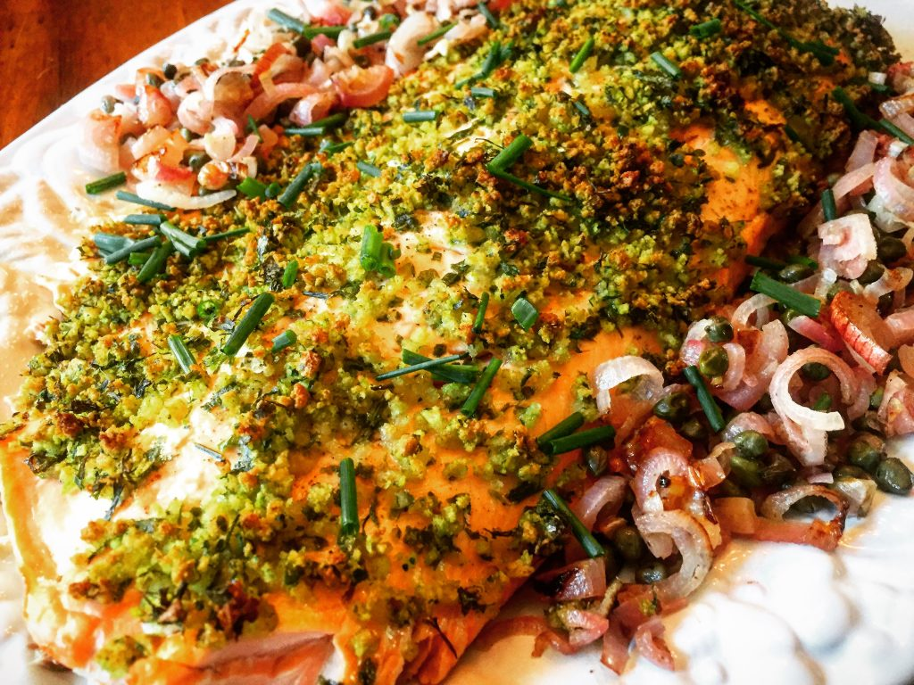 Succulent herb-crusted salmon with perfectly roasted shallots & capers