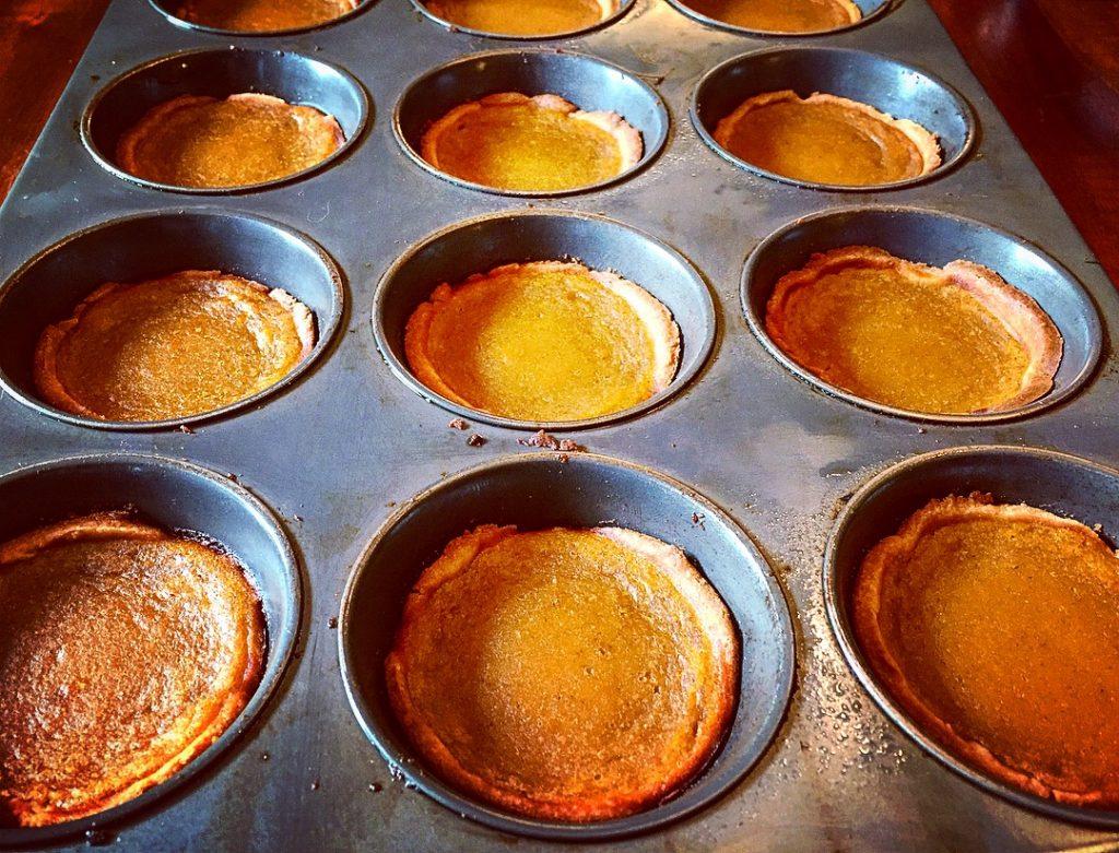 A dozen gorgeous gluten free & dairy free pumpkin butter tarts fresh out of the oven
