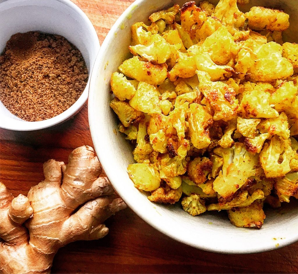 Roasted curried cauliflower florets ready to be included with other deliciously savoury ingredients
