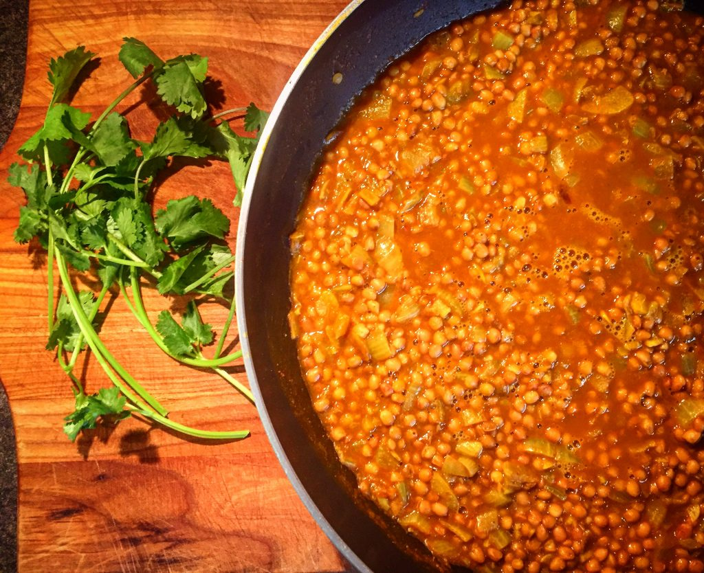 Indian dal makhani in a sumptuous curry sauce complete with fresh herbs, coconut milk and white wine